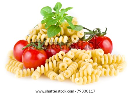 Fusilli pasta with tomatoes and basil over white background - stock photo