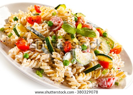 Fusilli pasta with white sauce and vegetables