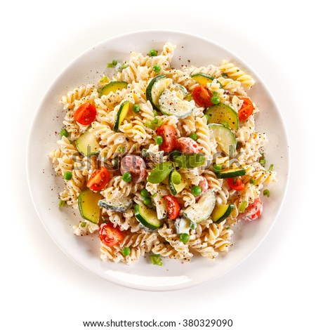 Fusilli pasta with white sauce and vegetables  - stock photo