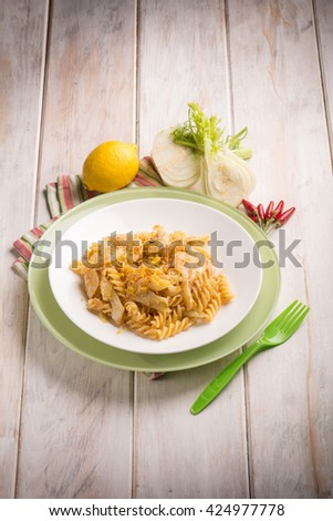 fusilli with  fennel grated lemon peel and hot chili pepper - stock photo