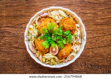 Fusion Cuisine, Homemade Food Creation. Thai Spicy Salad with Fried Shrimp Balls, Lemongrass, Coriander, Onion, Chilli. Sweet and Sour Taste. / Concept and Idea of Food Background, Style and Cooking. - stock photo