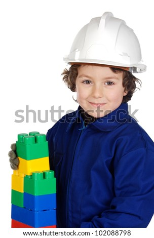 Future builder constructing a brick wall with toy pieces a over white background - stock photo