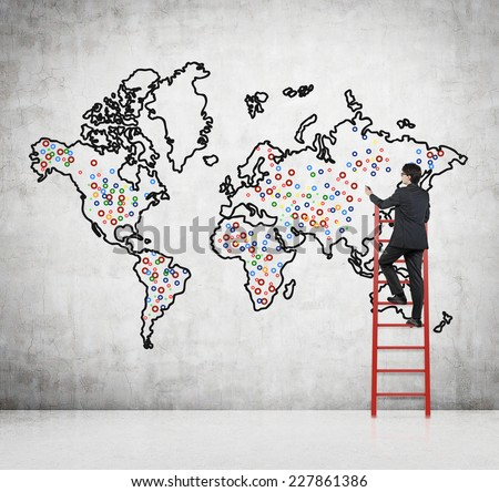 Future business developments strategy businessman drawing stock future business developments strategy businessman drawing the world map and the main points to expand gumiabroncs Gallery