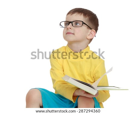 Future business man or scientist, a little boy with glasses and a book in his hand, close-up-Isolated on white background - stock photo