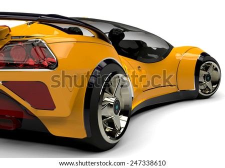 future car yellow bsck side view - stock photo