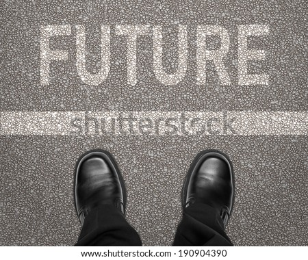 Future concept with business man feet and road markings - stock photo