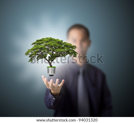 future eco - green energy concept, light bulb of tree in man hand - stock photo