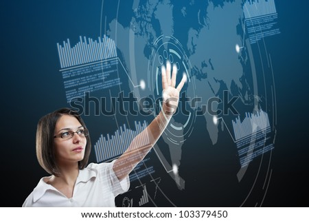 Future globe interface navigating by attractive businesswoman - stock photo