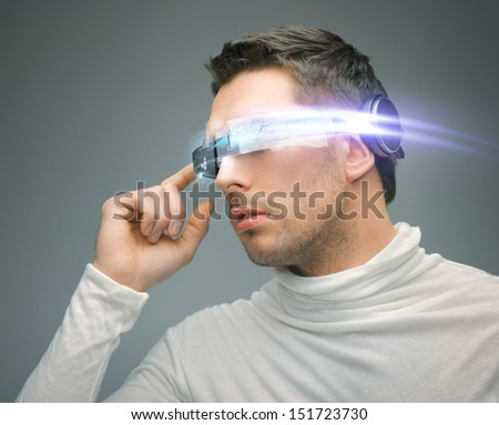 future technology and science fiction concept - man with digital glasses - stock photo