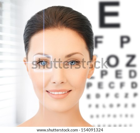 future technology, medicine and vision concept - woman and eye chart - stock photo