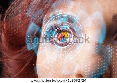 Future woman with cyber technology eye panel concept - stock photo