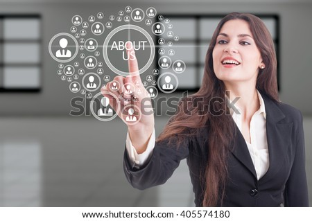 Futuristic about us concept on hi-tech touchscreen and business woman pressing button - stock photo