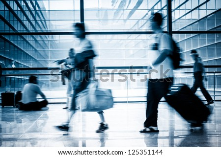 Futuristic  Airport interior people walking in motion blur - stock photo