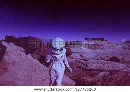 futuristic astronaut on another planet, Mars. image with the effect of toning - stock photo