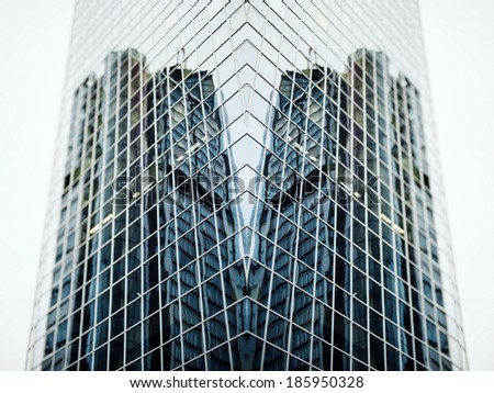Futuristic building with overlayed perspective wide angle view of a glass high rise building skyscrapers in modern futuristic downtown - stock photo