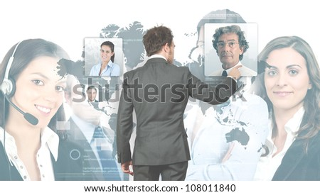 Futuristic conference among businessmen on virtual screen - stock photo