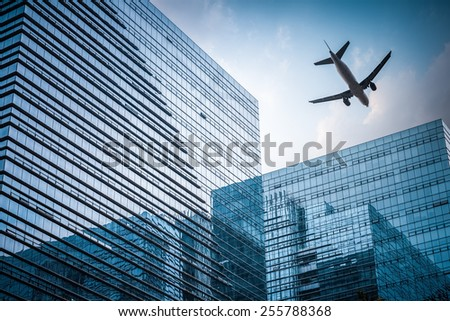 futuristic glass building with airplane , abstract reflection in the geometry space - stock photo