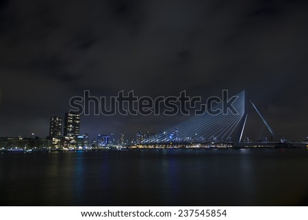 Futuristic modern bridge over water at night - stock photo