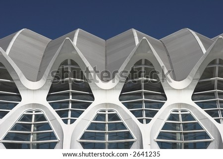 futuristic modern building with repetitive arches - stock photo