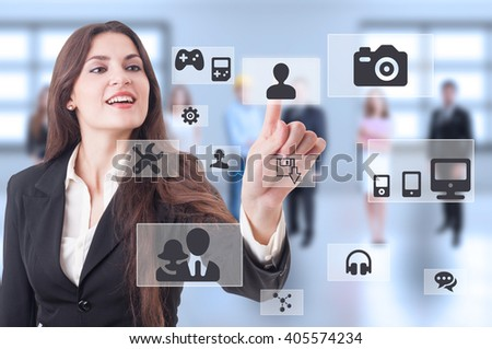 Futuristic multimedia connections as cloud computing concept with modern business woman pressing button - stock photo