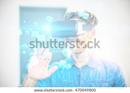 Futuristic screen with quaders against young man using the virtual reality headset