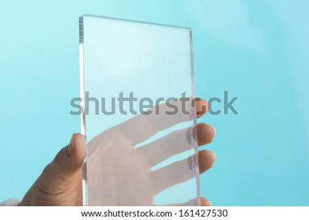 Futuristic Security Touch Screen Finger Pointing to Padlock Icon on Computer  - stock photo
