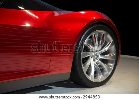 Futuristic sports cars front fender,  very dramatic styling. Partially  isolated on a black background, clipping paths included.  Look in my gallery for more car photos like this. - stock photo