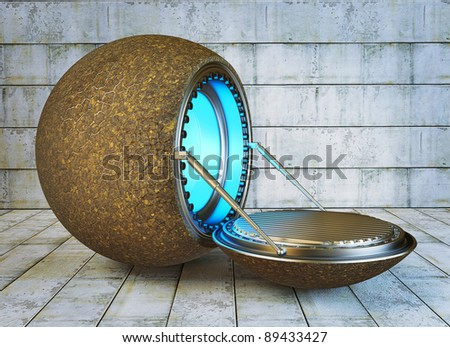 futuristic steel spaceship near a concrete wall. - stock photo