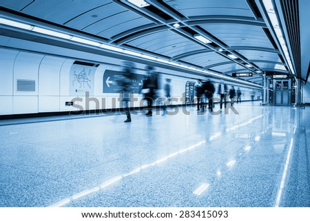futuristic subway passage with passengers motion blur in guangzhou