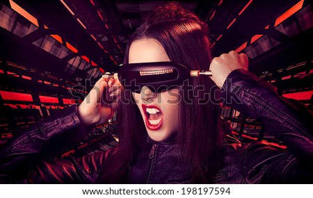 Futuristic woman getting unplugged - stock photo