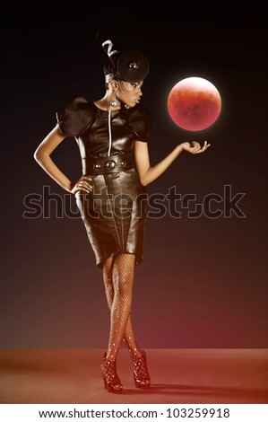 Futuristic woman with red moon - stock photo