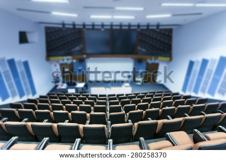 Fuzzy university classroom - stock photo
