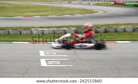 ga kart in race in the circuit - stock photo
