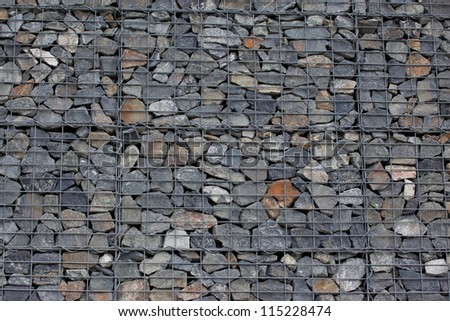 Gabion wall made of grey stones - stock photo