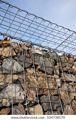 Gabion wall made of natural stones - stock photo