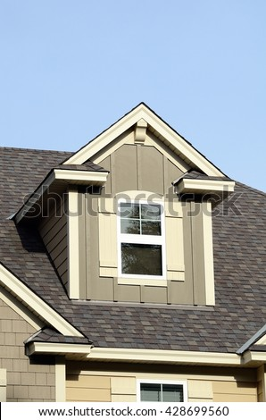 Gable Dormers and Roof of Residential House - stock photo