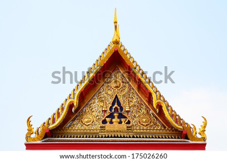 Gable roof on Thai temple  wiht blue sky in  Bangkok, Thailand
