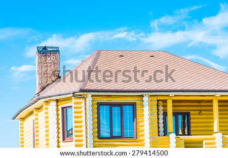 gable roof private residential new modern house with a window - stock photo