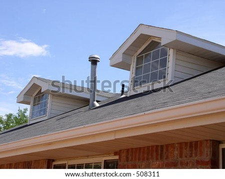 gables on the roof of a brick house