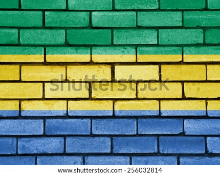 Gabon flag painted on old brick wall texture background - stock photo