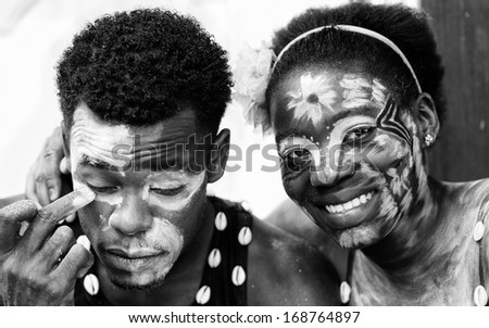 GABON - MARCH 6, 2013: Unidentified Gabonese couple put white paint on their face in Gabon, Mar 6, 2013. People in Gabon suffer of poverty due to the unstable economical situation