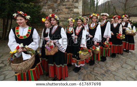 Gabrovo, Bulgaria- April 8, 2017: The girls decorate in a colorful and rich way their hairs and go around the village singing songs and dancing, in this way showing they are ready to get married.