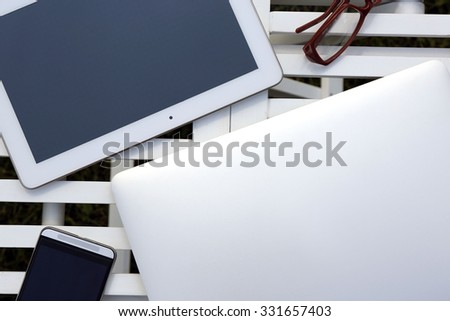 Gadgets on wooden table closeup