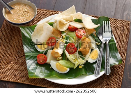 gado gado, indonesian salad with peanut sauce - stock photo