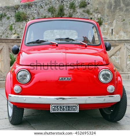 GAETA, ITALY - JUNE 25, 2016: Fiat 500 on the street in the center of Gaeta. Fiat 500 was produced by the Fiat company from 1957 to 75. New version of the car started production in 2007, Gaeta