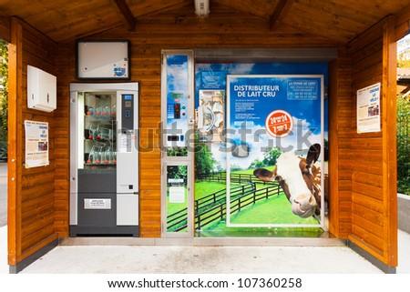 GAILLARD, FRANCE - SEPTEMBER 21, 2010:  A unique automated milk vending machine can dispense fresh milk 24 hours a day on September 21, 2010 in Gaillard, France - stock photo