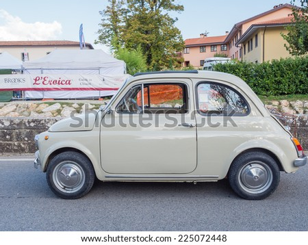GAIOLE IN CHIANTI, ITALY - 4 OCT. 2014: A vintage Fiat 500 car at  L'Eroica, a historic cycling route in Chianti, which also uses other vintage vehicles to enhance the period atmosphere - stock photo