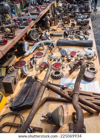 GAIOLE IN CHIANTI, ITALY - 4 OCT. 2014: Vintage bike parts on display at L'Eroica, a historic cycling event for owners of vintage bicycles who ride through the province of Tuscany on gravel roads. - stock photo