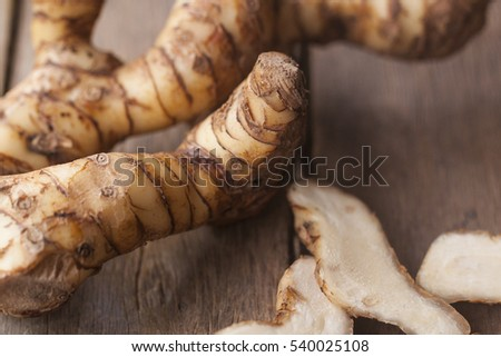 galanga known as aromatic ginger on wooden background.