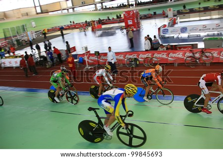GALAPAGAR, SPAIN APRIL 6 - Cyclists in full competition for the final races of the championship of Spain for indoor track cycling teams - Cycle track of Galapagar,Spain April 2012